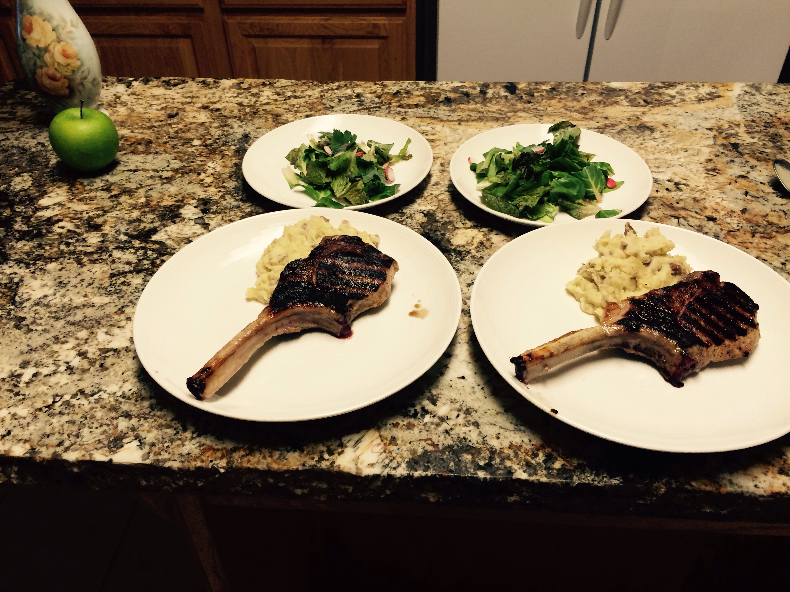 Chime bone pork chops  with fresh winter greens all from our farm